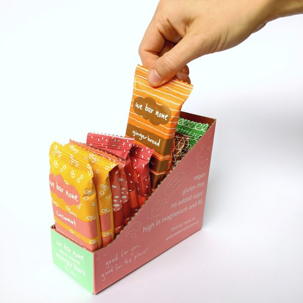 12 pack of We Bar None bars in a shelf ready display box. Victoria's first home compostable snacks.